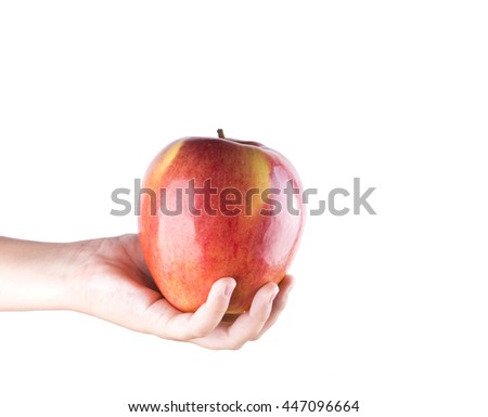 Children hand with an apple isolated on white background.  big juicy apple - stock photo