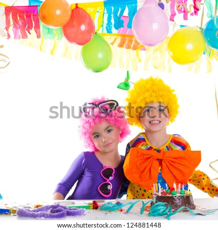 Children happy birthday party with clown wigs and chocolate cake - stock photo