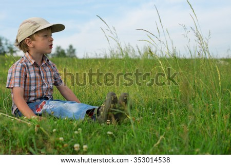 Children have a rest at the lake on a summer day - stock photo