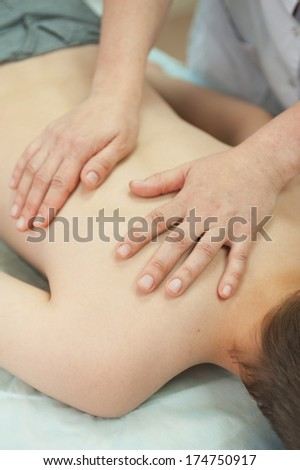 Children having a massage at spa