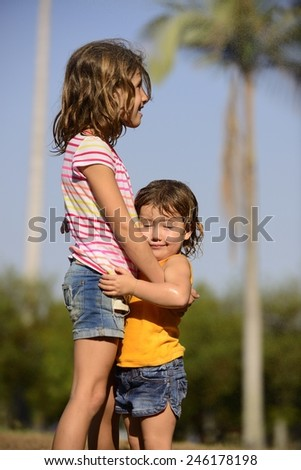 Children having fun in tropical summer rain - stock photo