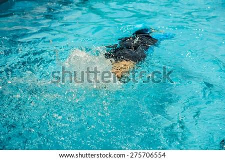 children having fun to the swimming pool - stock photo