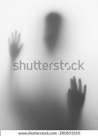 Children head and hands silhouette on glass