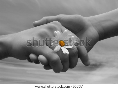 Children holding hands, symbolizing friendship. Black and white version - stock photo