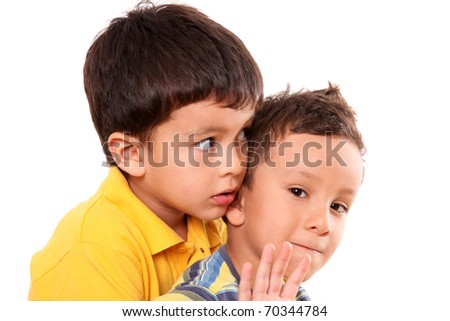 Children huddled looking at different directions with a hand in sign of stop