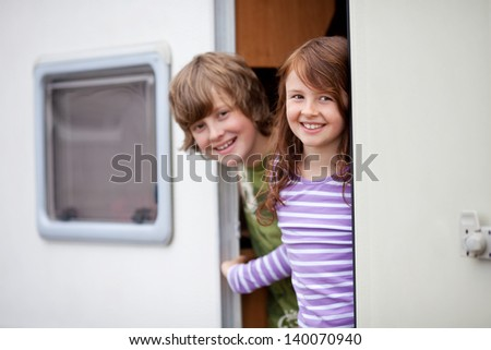 Children In A Caravan - stock photo