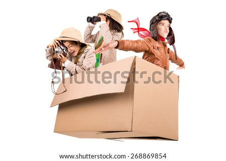 Children in a cardboard box playing Safari - stock photo