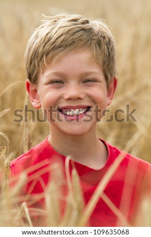 children in a wheat field - stock photo