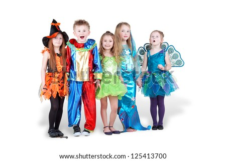 Children in carnival costumes  stand holding hands with different facial expressions - stock photo