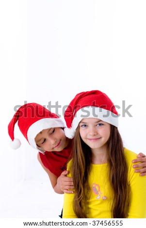 Children in christmas caps on a white background