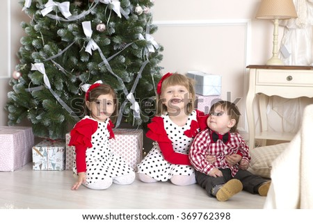 children  in christmas decorations