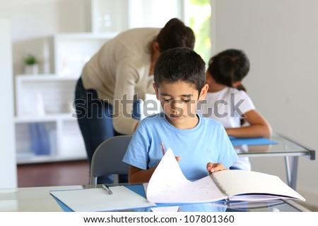 Children in class with teacher - stock photo