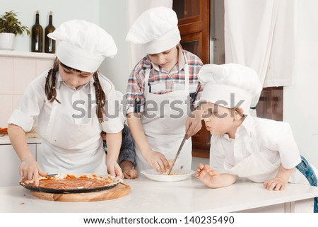 Children in clothes cooks - stock photo