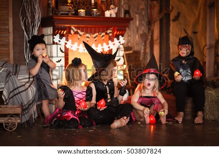 children in costume on a dark background, concept mysterious childhood halloween,