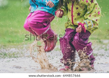 Children Rubber Boots Rain Clothes Jumping Stock Photo