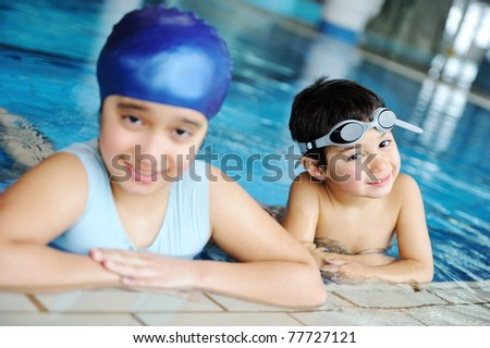 Children in swimming pool learning swimming. Sport. - stock photo