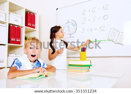 Children in the classroom during the lesson. Educational concept.
