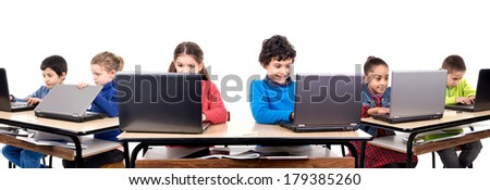 Children in the classroom with laptop computers - stock photo