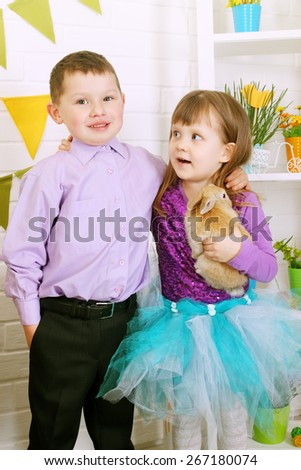 children in the interior decorations to the day of Easter - stock photo