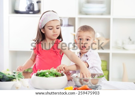 Children in the kitchen preparing salad