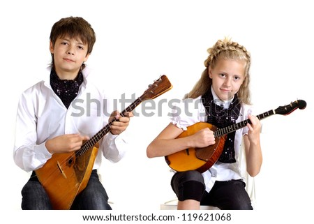 Children in the school of music on a white background - stock photo