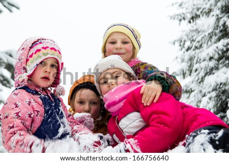 Children in the snow in winter - stock photo