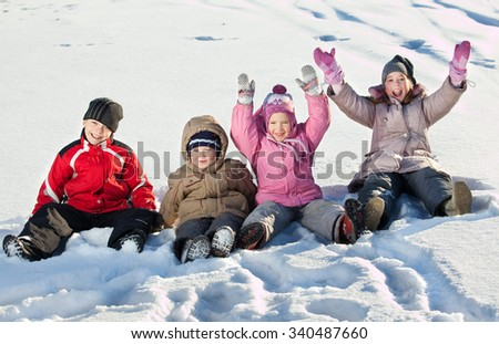 Children in the snow in winter. - stock photo