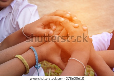Children join forces - stock photo