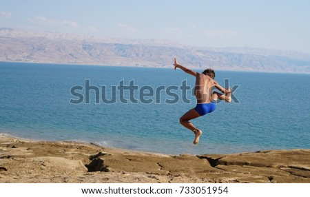 children jump from the mountain...beauty of  dead sea...