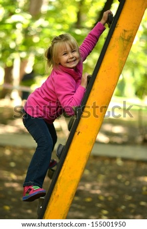 children kid girl play on a park playground - stock photo