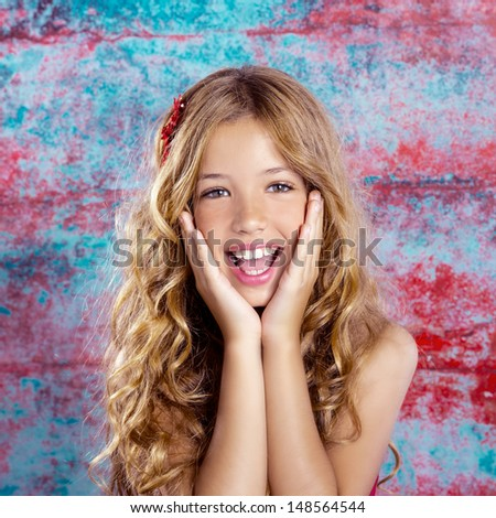 children kid girl smiling surprised expression with hands in face in colorful grunge background - stock photo