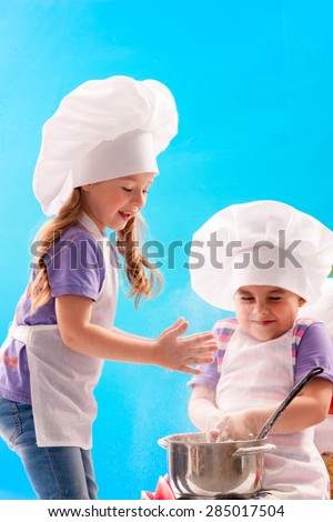Children laugh, stirring cream - stock photo