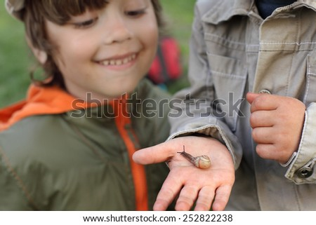 children learn snail, focus on snail - stock photo