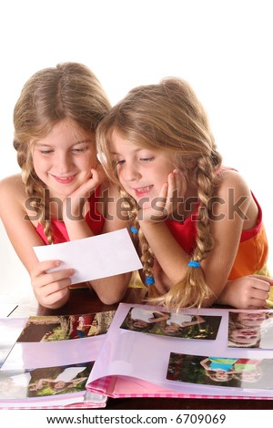 children looking at photos together vertical - stock photo