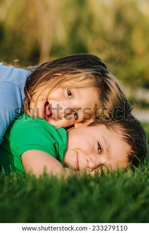 Children Lying On Grass - stock photo