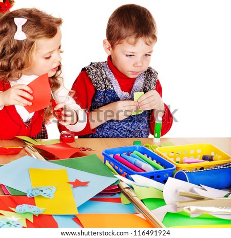 Children making card. Isolated on white. - stock photo