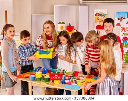 Children making greeting Xmas card.  - stock photo