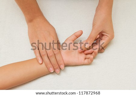 children massage with mother hand