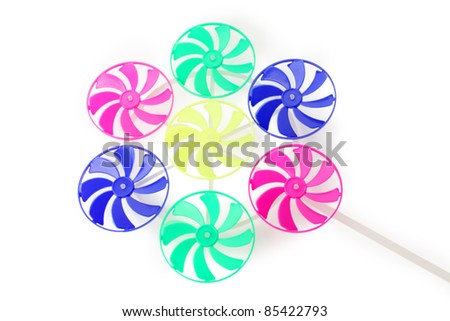 Children multi-colored toy which consists of seven windmills - stock photo