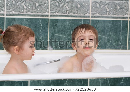 Children Of Four And Seven Years Old In The Bath. Closeup