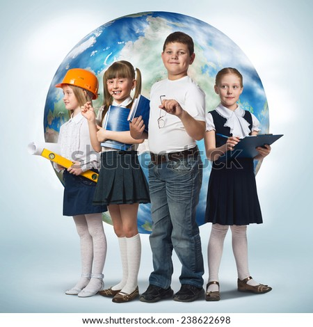 Children of school age trying different professions. Elements of this image are furnished by NASA - stock photo