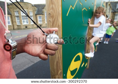 Children On Climbing Wall In School Physical Education Class - stock photo