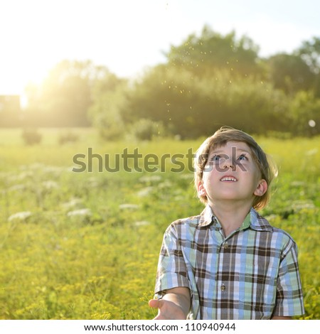 children on green meadow in nature - stock photo