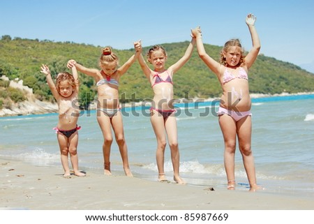 children on the beach - stock photo