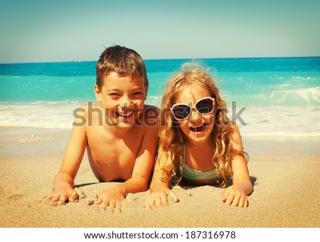 Children on the beach. Girl at vacations on sea - stock photo