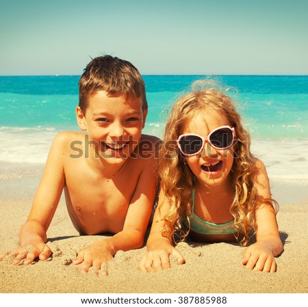 Children on the beach. Girl at vacations on sea