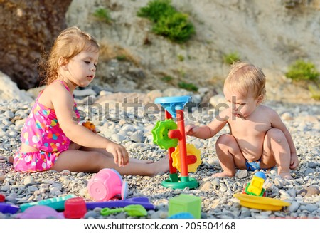 children on the beach playing toys - stock photo