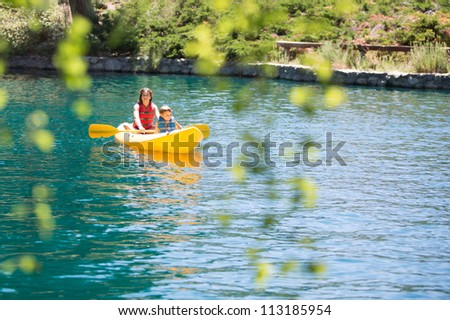 Children on the Lake - stock photo
