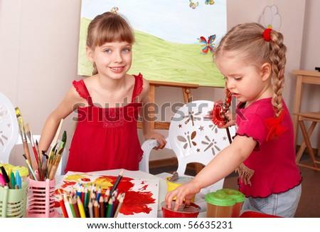 Children painting colour paints in preschool. - stock photo