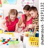 Children painting with teacher. Child development. - stock photo